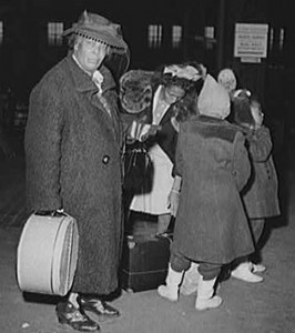 Archival picture from the 1940s of a family awaiting a train in Chicago.