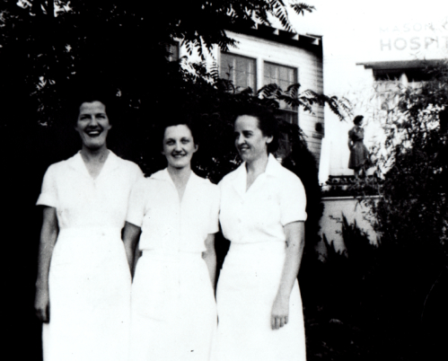 Black and white photo of 3 Permanente nurses standing in front of Mason City Hospital
