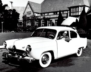 Henry J. Kaiser in car on a lawn in 1951