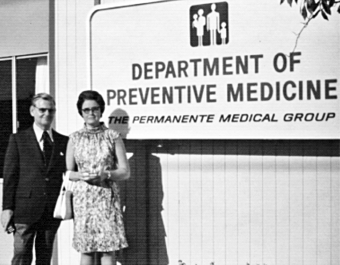 Man and woman standing in front of sign that reads Department of Preventive Medicine
