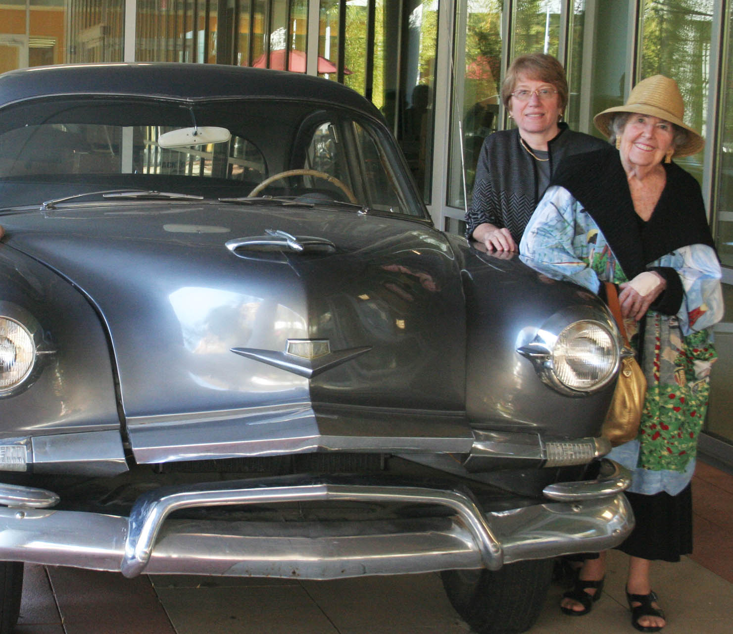 Elizabeth Sandel, MD, and Bobbie Kaiser in 2010 with the 1953 Kaiser Manhattan automobile.