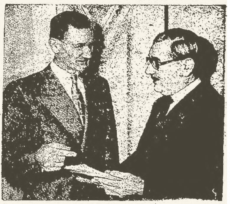Carl Brown (left), president of the Independent Foremen's Association of America, confers with Harry F. Morton while representing Kaiser-Frazer. UPI newspaper photo, 2/19/1949.
