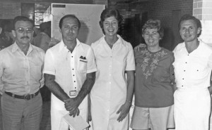 Sandra Weisner, at center, head of nursing for Project Hope, helped Lori to a bed when she fell ill while boarding the ship. Martin Shearn, MD, is pictured at the far right. Project Hope photo