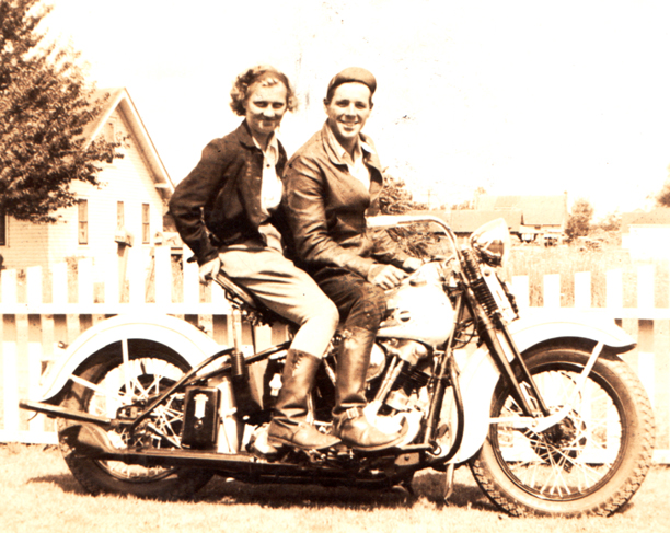 Phyllis Gould and husband Buster on their Harley-Davidson motorcycle