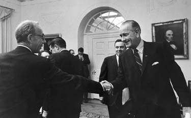 Edgar F. Kaiser, left, then chairman of the Kaiser Foundation Hospitals and Kaiser Foundation Health Plan, and President Lyndon B. Johnson shake hands at a White House reception in 1968.