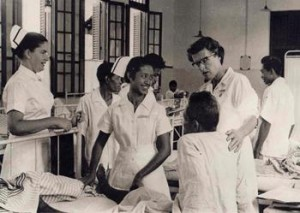 This photo comes from 1960 during the inaugural voyage of the SS HOPE to Indonesia, when American and Indonesian nurses worked together to help patients with tropical diseases.