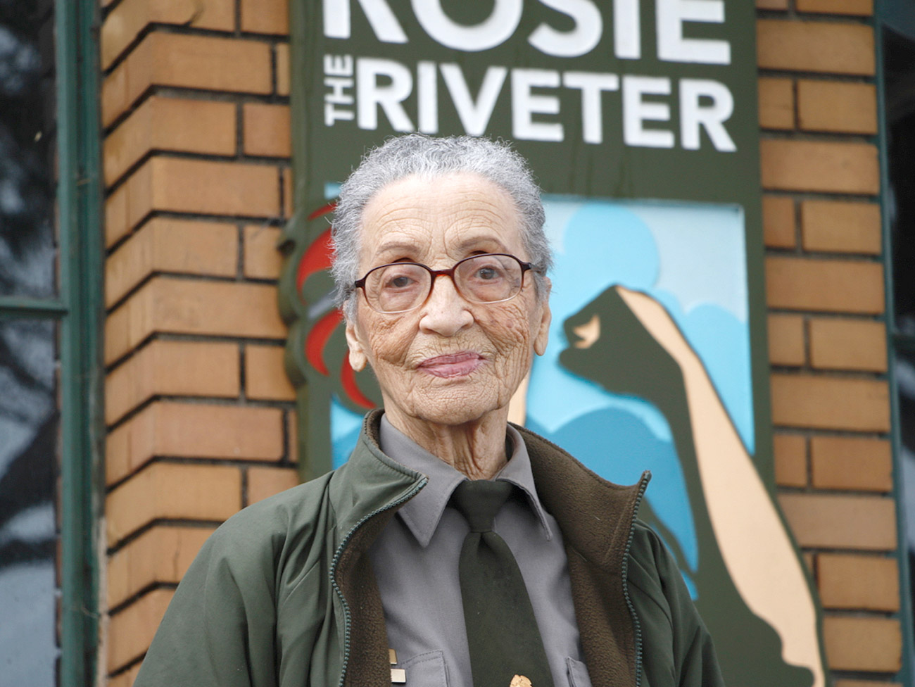 Park Ranger Betty Reid Soskin standing in front of the Rosie the Riveter Museum in Richmond, CA