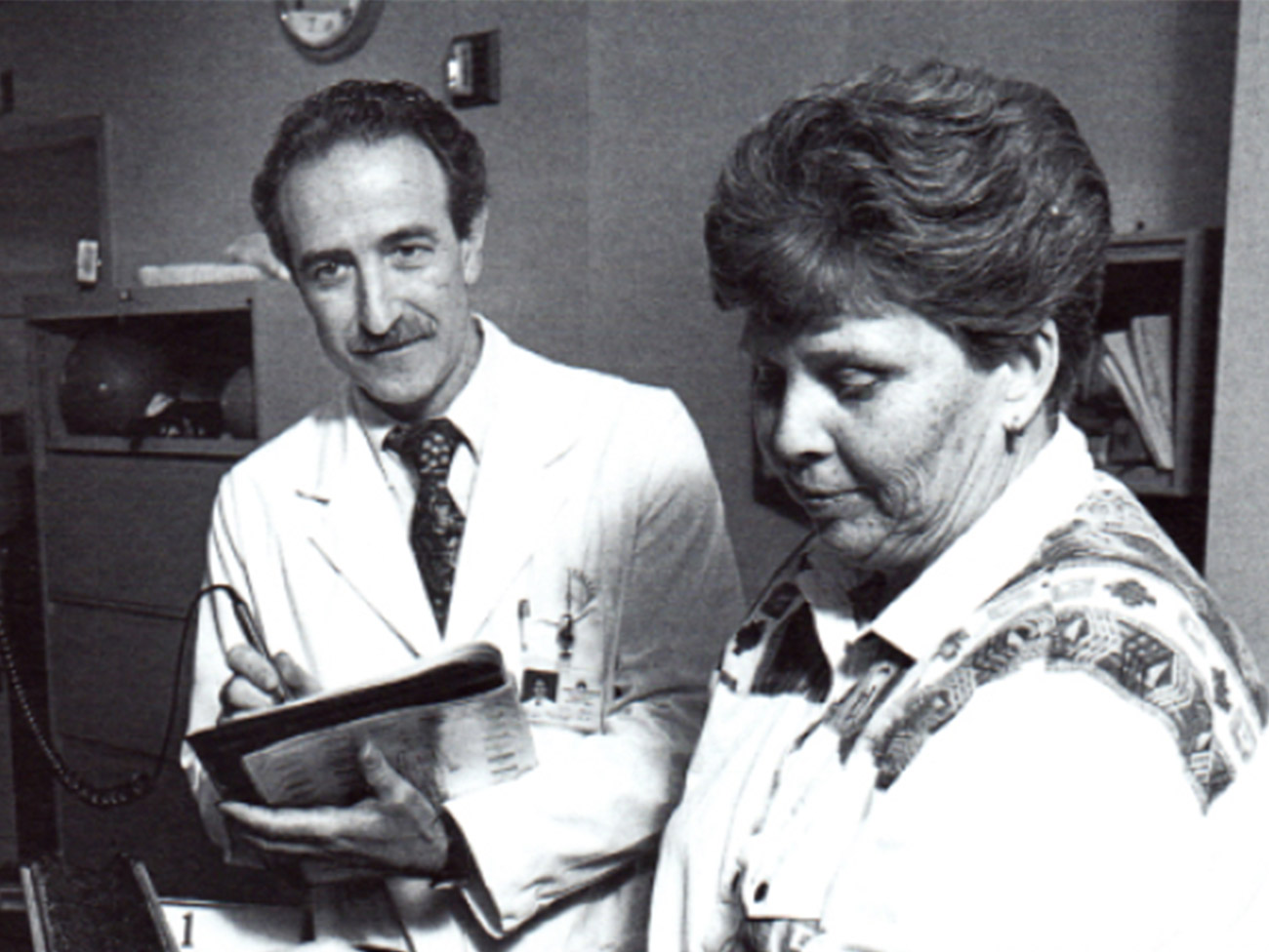 Peter Estacio, MD working with a patient