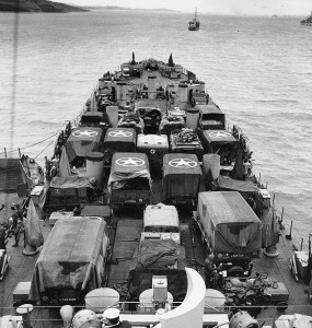 Black and white image of ship with tanks
