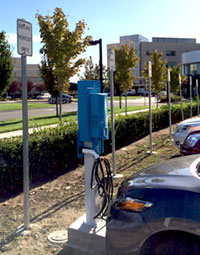 A blue car parked at a blue charging station at Vacaville Medical Center