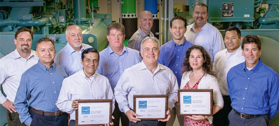 People working at Kaiser Permanente Data Centers holding Energy Star award certificates