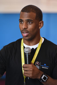 Chris Paul holding a microphone