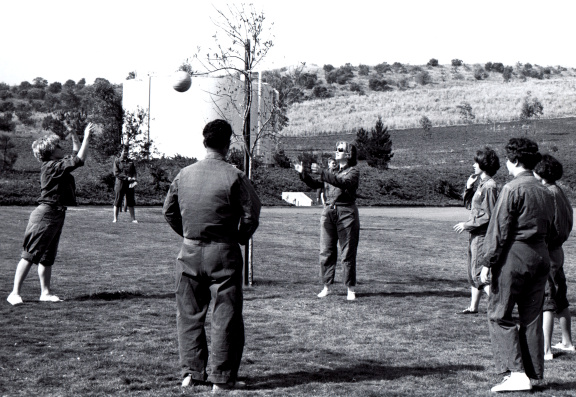 1967 black and white photo of a group of people playing tetherball.