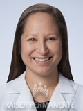 photo of Kapua Medeiros, MD wearing a lab coat