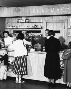 Pharmacist Julian Weiss at counter of Kaiser Oakland Hospital pharmacy, late 1940s.