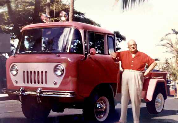 Henry J. Kaiser standing next to a pink FC-170 Jeep truck in 1958