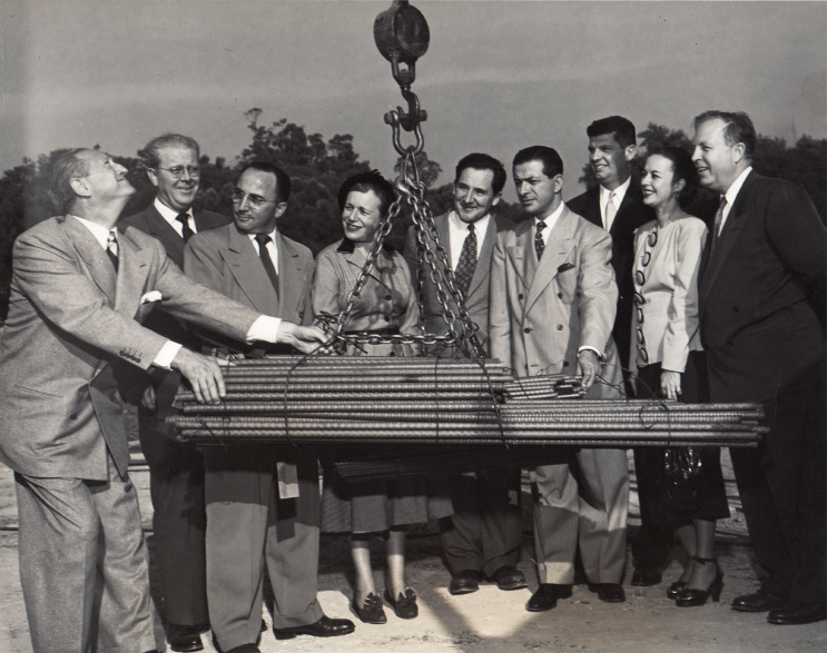 Group of men and women at a ground breaking ceremony in 1953