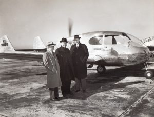 Henry J. Kaiser at first test flight of experimental pusher 'family' plane.