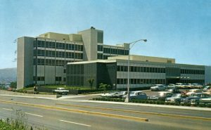 Postcard of Bess Kaiser Hospital, Oregon, printed 1959. Given by Rube Bingham to daughter Laura Robertson, with message on back. Floors 3-5 are numbered by hand. Gift of Laura Robertson.