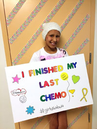 Alex Henry holding a sign that says, I finished my last Chemo