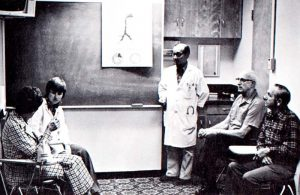 Kaiser Permanente physician Isamu Nieda, MD standing in front of a group of people in 1975.