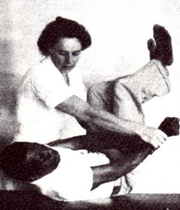 1951 image of a female nurse with a male patient