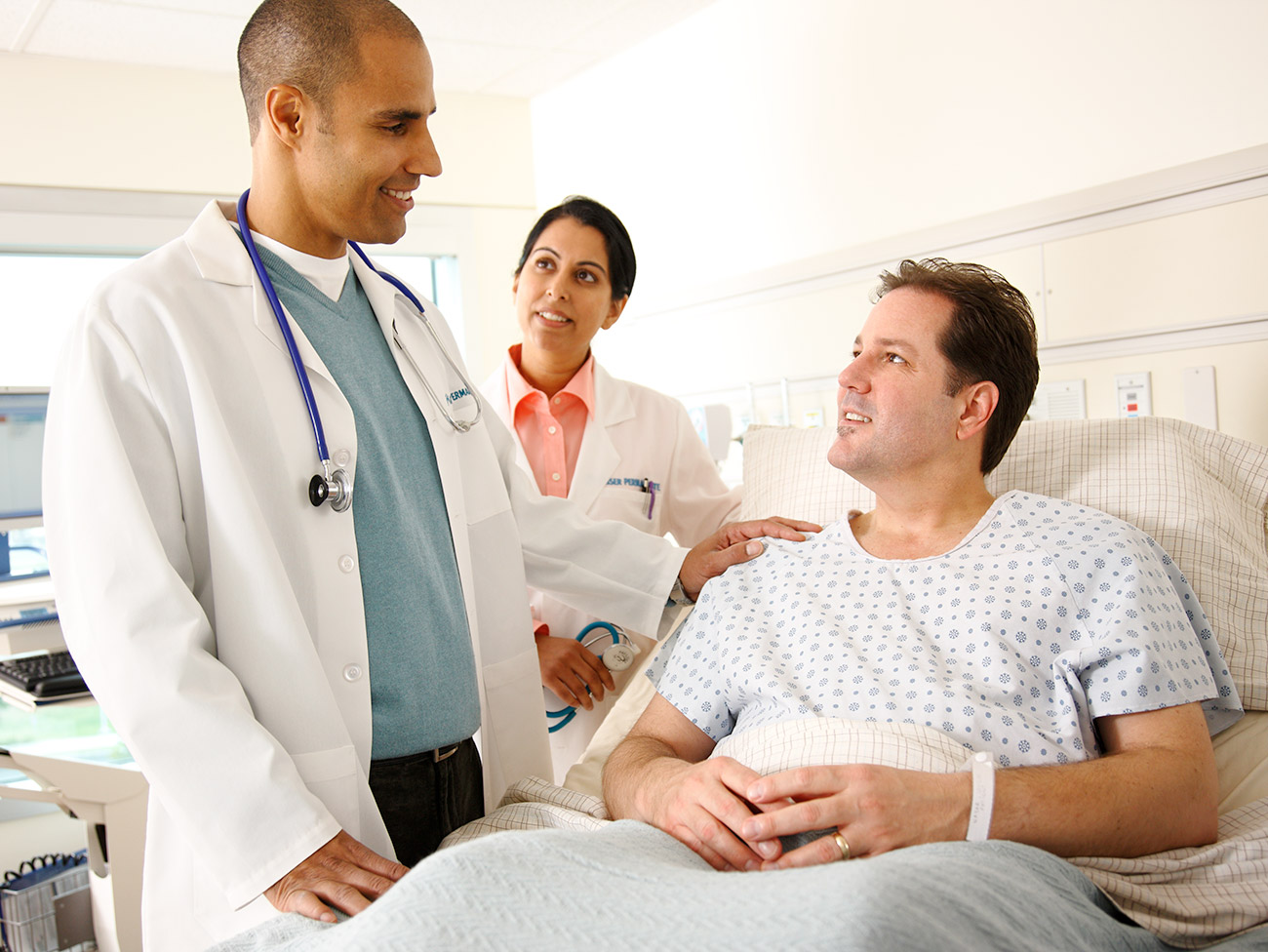 Doctor and nurse speaking to patient