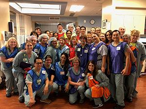 large group of people who helped deliver quintuplets
