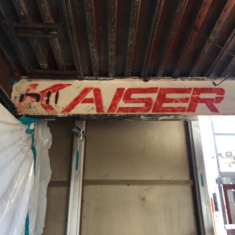 I beam with the word KAISER in red letters