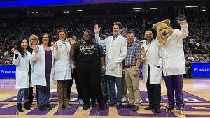 Sondra (center), Dr. Boskovitz, Dr. Crawford and other members of Sondra's care team were reunited during a Sacramento Kings game caregiver reunion night.
