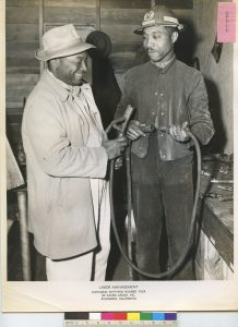 1944 image of two black workers at the Kaiser Richmond shipyard.