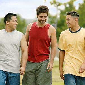 Three young men in casual dress, walking outdoors