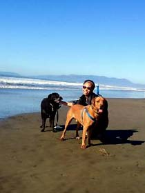Alyce Adams, PhD and her two dogs on the beach