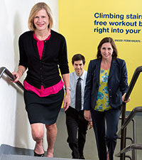 Deborah Rohm Young, PhD, MBA, walking up the stairs at work with colleagues