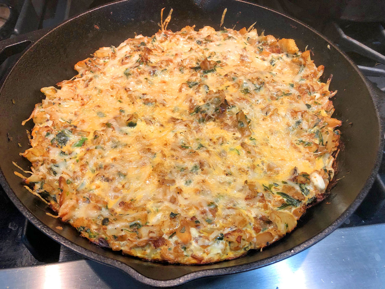 Persian cauliflower and herb frittata in a cast-iron skillet