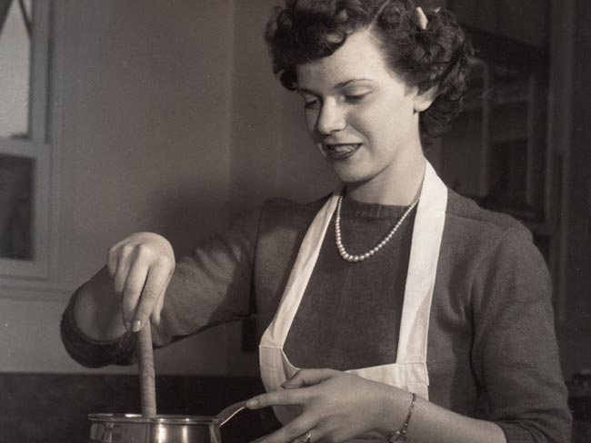 1947 image of Kaiser Foundation School of Nursing student Frances E. Weir in the Cooking Laboratory