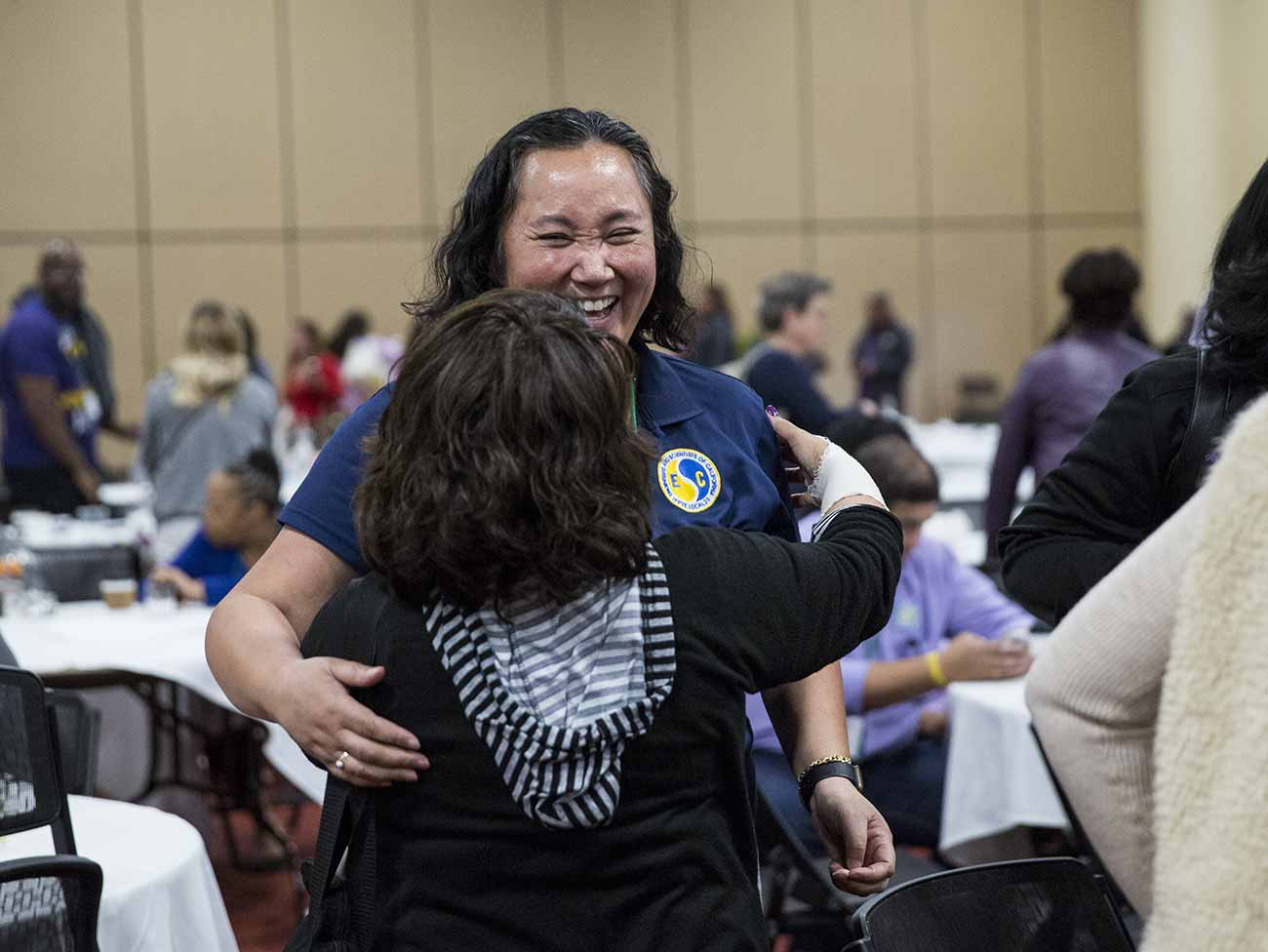 Two women hugging during the coalition bargaining