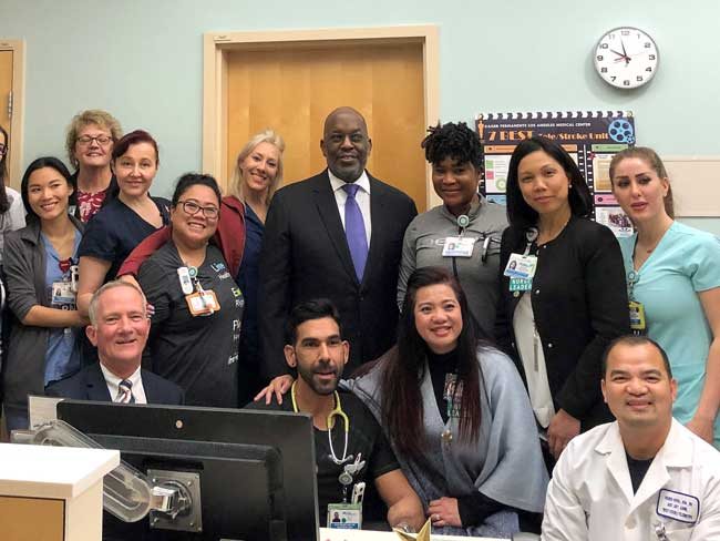 Bernard J. Tyson posing with a group of Kaiser Permanente nurses in Los Angeles