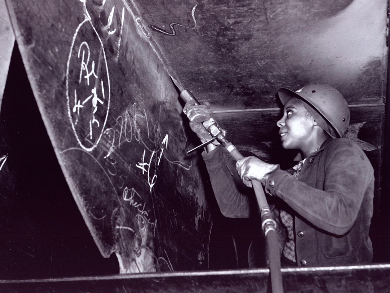 Eastine Cowner, a scaler at Kaiser Richmond Shipyard, working on Liberty ship SS George Washington Carver
