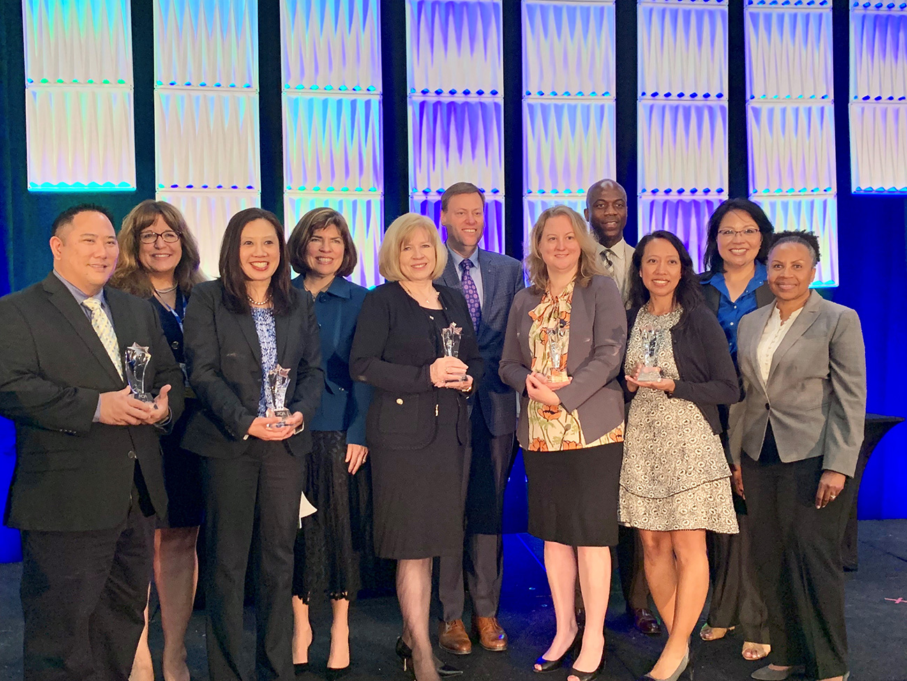 Kaiser Permanente's national pharmacy leaders accept the PQA award.