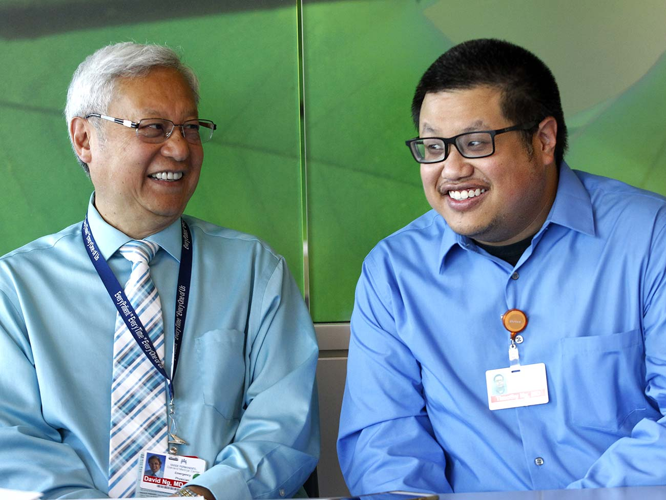 Kaiser Permanente physicians David Ng, MD and Timothy Ng, MD, sharing a laugh together.