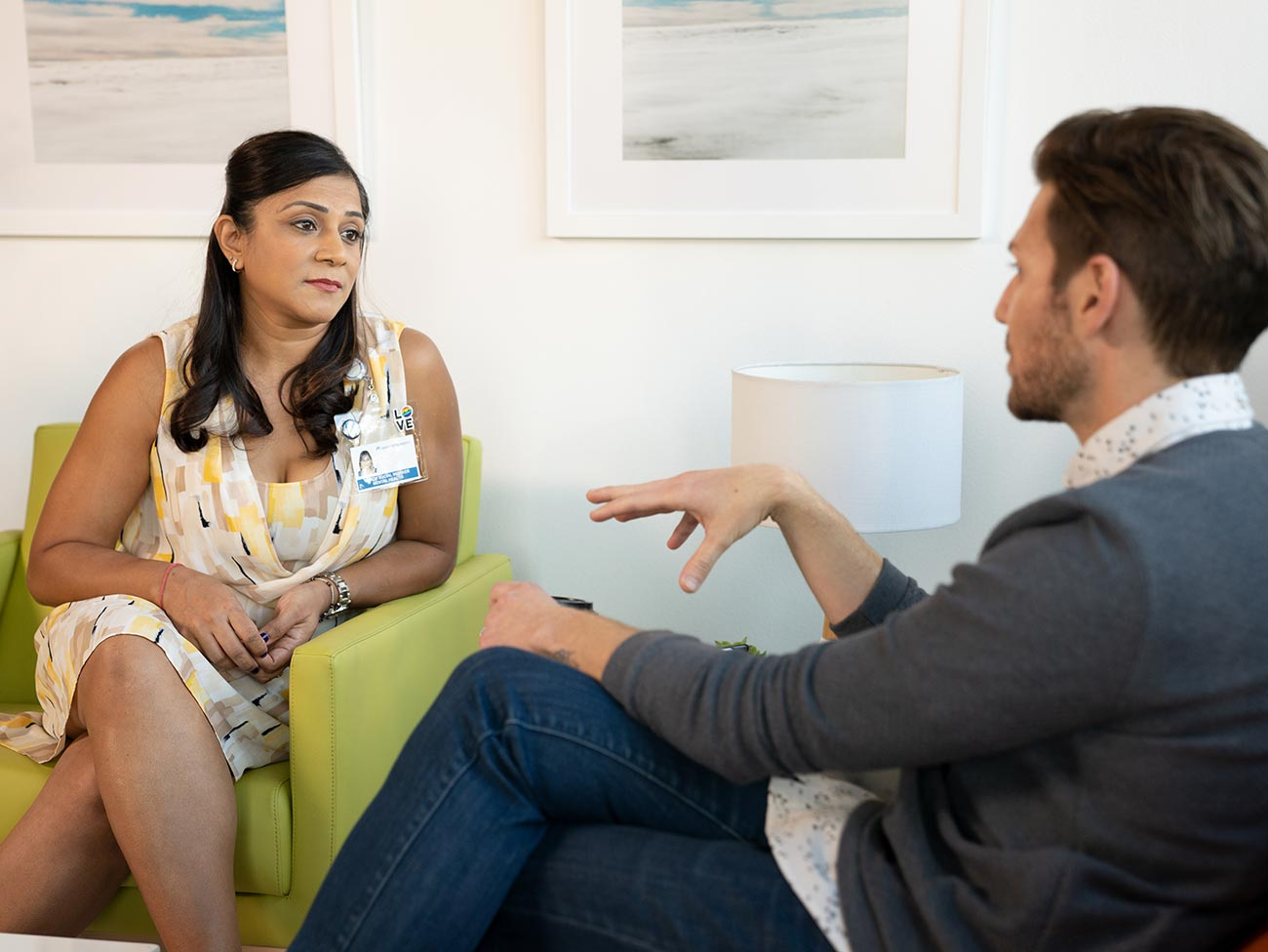 Female therapist consulting with a male patient.
