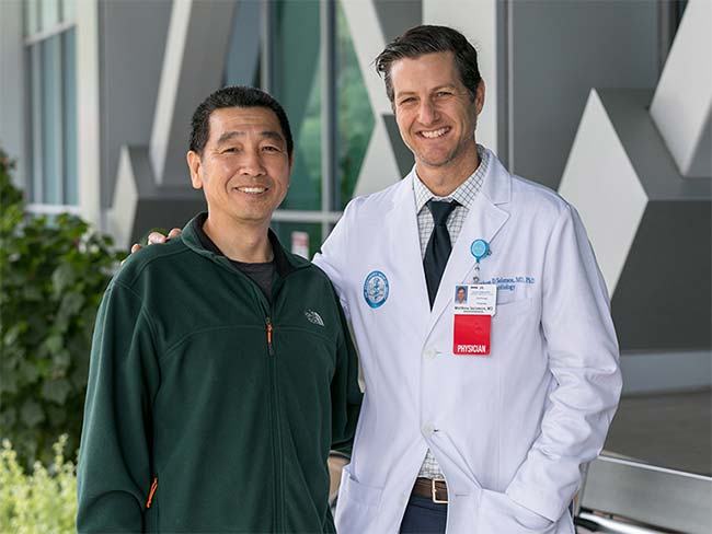 Rong Fang and cardiologist Matthew Solomon, MD