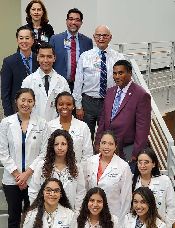 2019 Apothecary Circle Pharmacy program interns and their mentors posing, standing in a staircase.