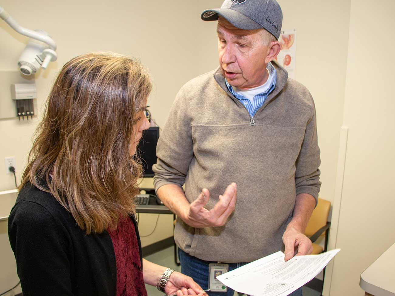 Kaiser Permanente Northwest member Bob confers with nurse navigator Bobbie Provence about his treatment and care plan.
