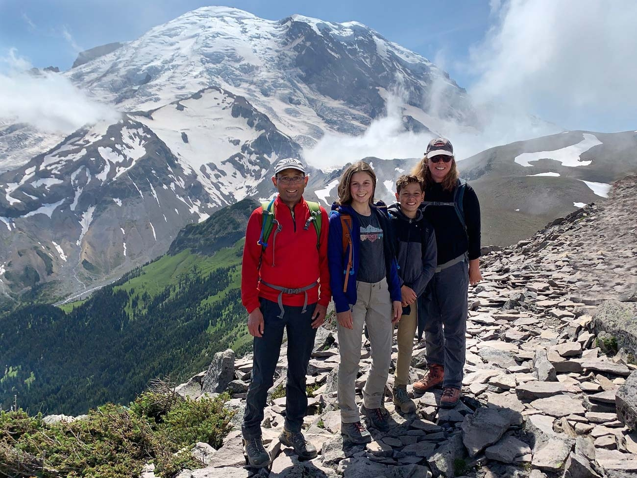 Dr. Karen Wernli, her husband, and their daughter and son on Burroughs Mountain trail, with Mount Rainier in the background