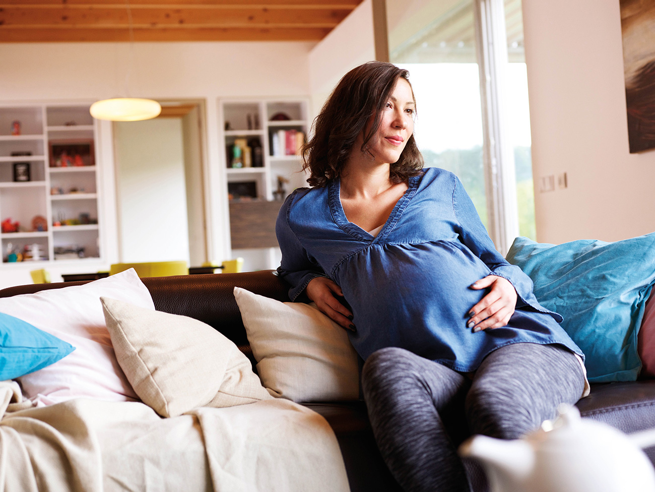 Pregnant woman on couch