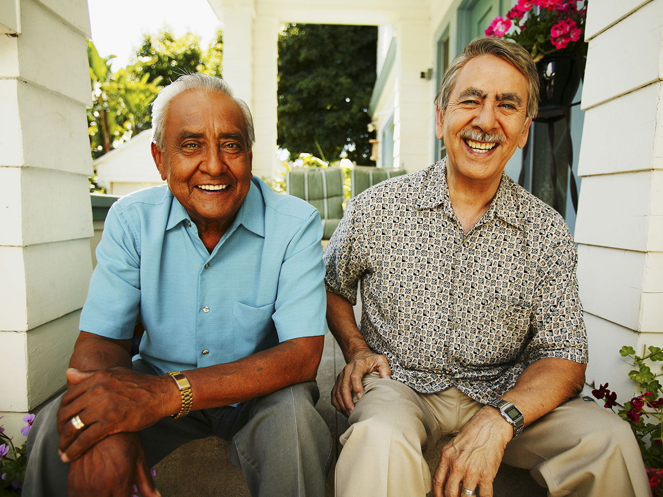 Two senior men sitting on a porch