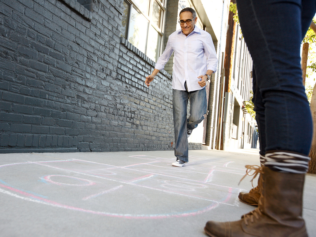 Man playing hopscotch