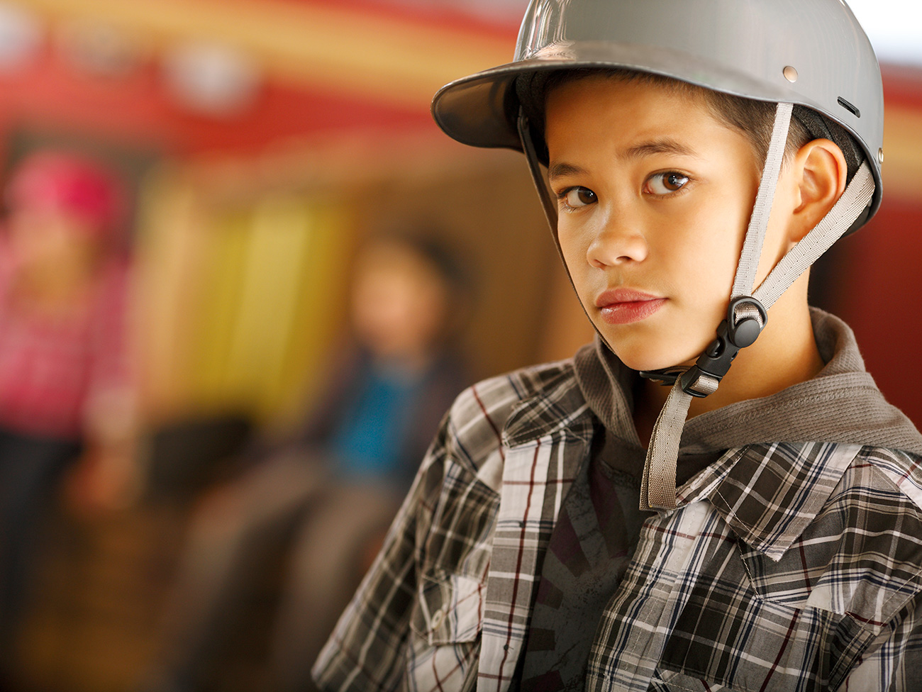 Child wearing skateboard helmet